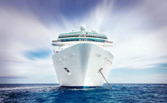 Front view of a cruise ship at sea with cellular network