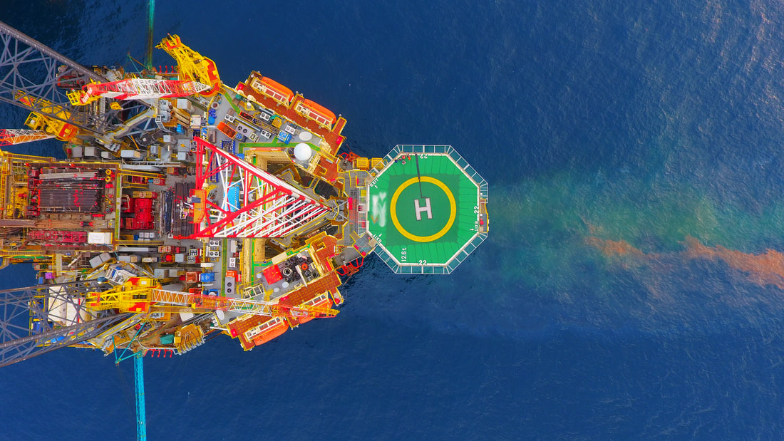 Aerial view of oil rig, connected via satellite cellular connectivity