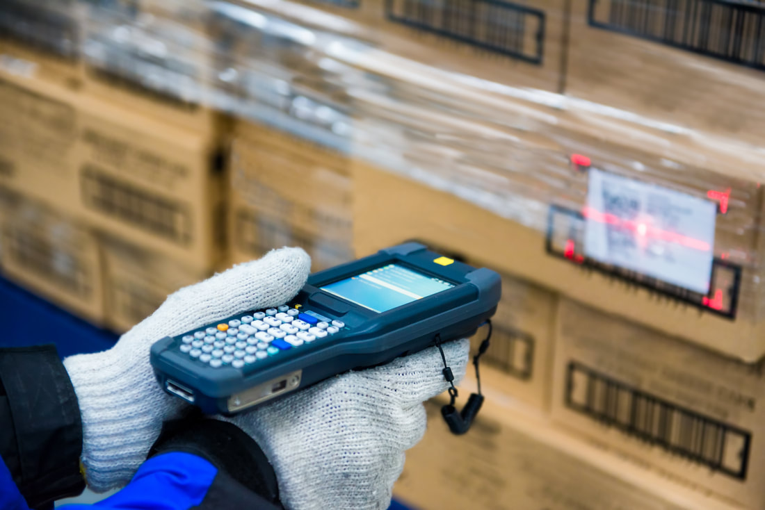Barcode scanner scanning for the asset tracking of goods in a cold container